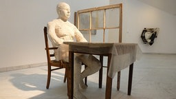 George Segal: Man Seated at Table