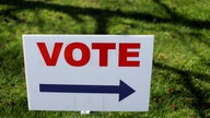A Vote sign directs voters to an early
