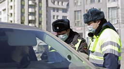 02.04.2020, Russland, Novosibirsk: NOVOSIBIRSK, RUSSIA - APRIL 2, 2020: Traffic police officers work during the outbreak of the novel coronavirus disease (COVID-19).