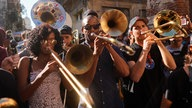 New Orleans musicians parade in downtown Havana