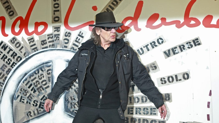 Udo Lindenberg poses during the unveiling of the 'Friedenswand', a picture created by four artists and singer Udo Lindenberg