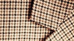 Nahaufnahme von einem Jacket aus Tweed.