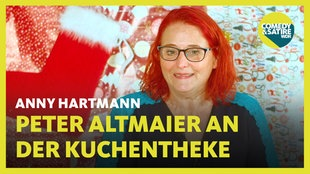 Anny Harmann - Peter Altmaier an der Kuchentheke